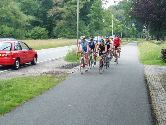 Fast racing cyclists on a wide Dutch cycleway.