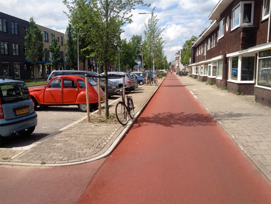 The smooth red asphalt of a Dutch cycleway.