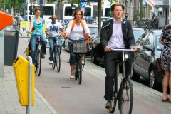 A random group of people cycling on a cycle path in Utrecht