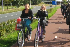Two girls riding alongside each other and chatting as they travel