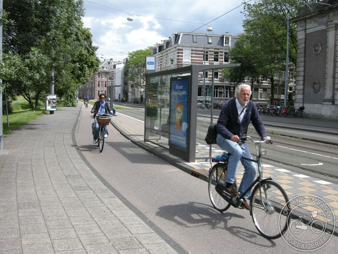 A bus-stop-bypass in Amsterdam (actually a tram stop bypass!). The cycle path runs around the rear of the stop, so people using it don't have to stop.