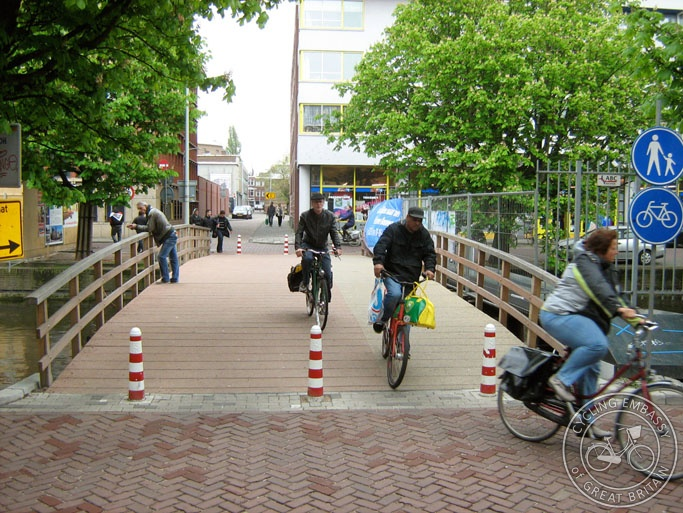 A photo of a wide but temporary walking and cycling bridge in The Hague, the Netherlands.