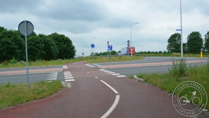 Bi-directional cycleway with clear priority across road, Elst, NL