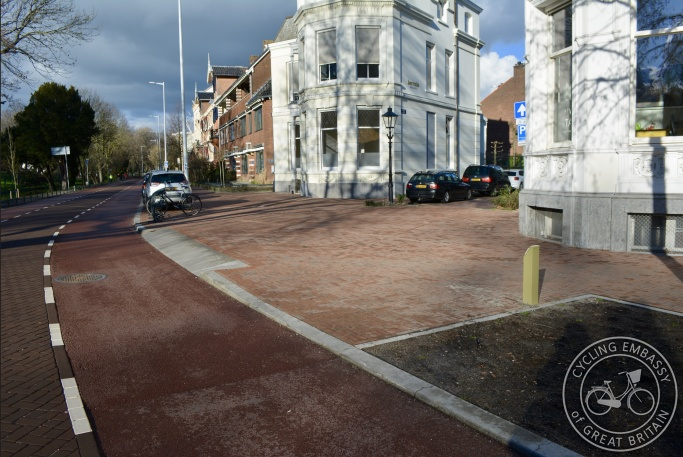 Narrowed road with continuous footway and wide cycle lanes, Utrecht, NL