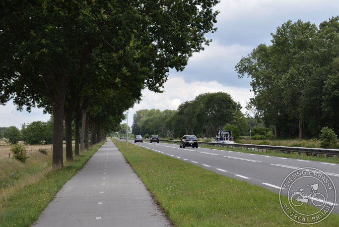 Cycle path alongside rural main road, Drenthe, The Netherlands