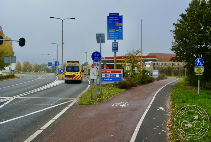 Cycle path passing behind petrol station, Gouda, The Netherlands