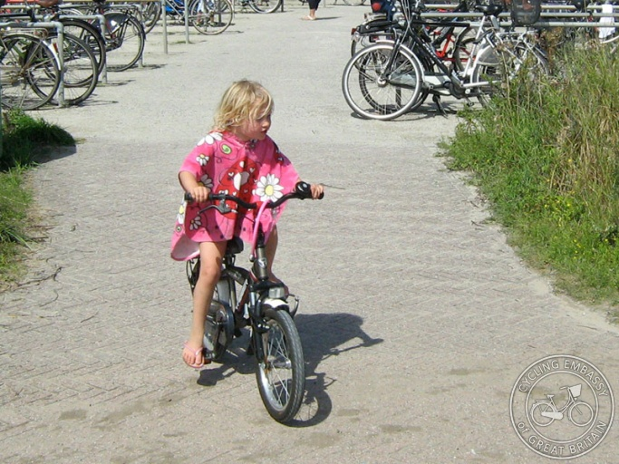 Little girl riding bike cycling embassy of great britain for Little motors for bicycles