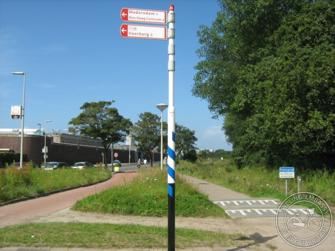 Two cycle paths run parallel with a grass strip between them