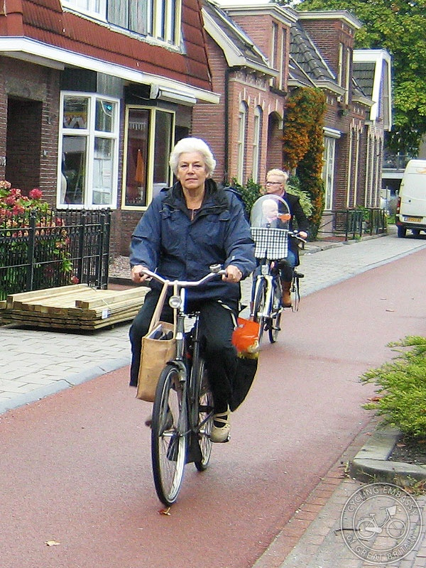 Older Woman Riding With Shopping Cycling Embassy Of
