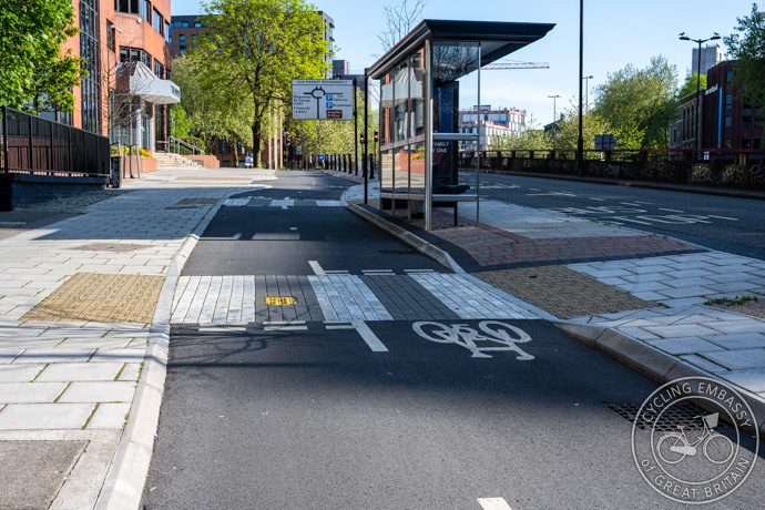 A bus stop bypass on a bi-directional cycle track with zebra crossings and angled kerbs